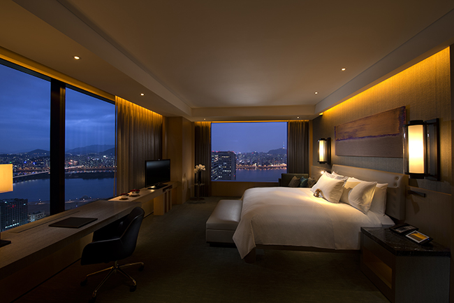 The Executive Suite at the Conrad Seoul with a view of the skyline.