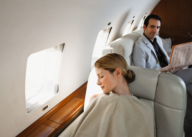 Light exposure and scheduled sleep can help you avoid jet lag. Image by Corbis.