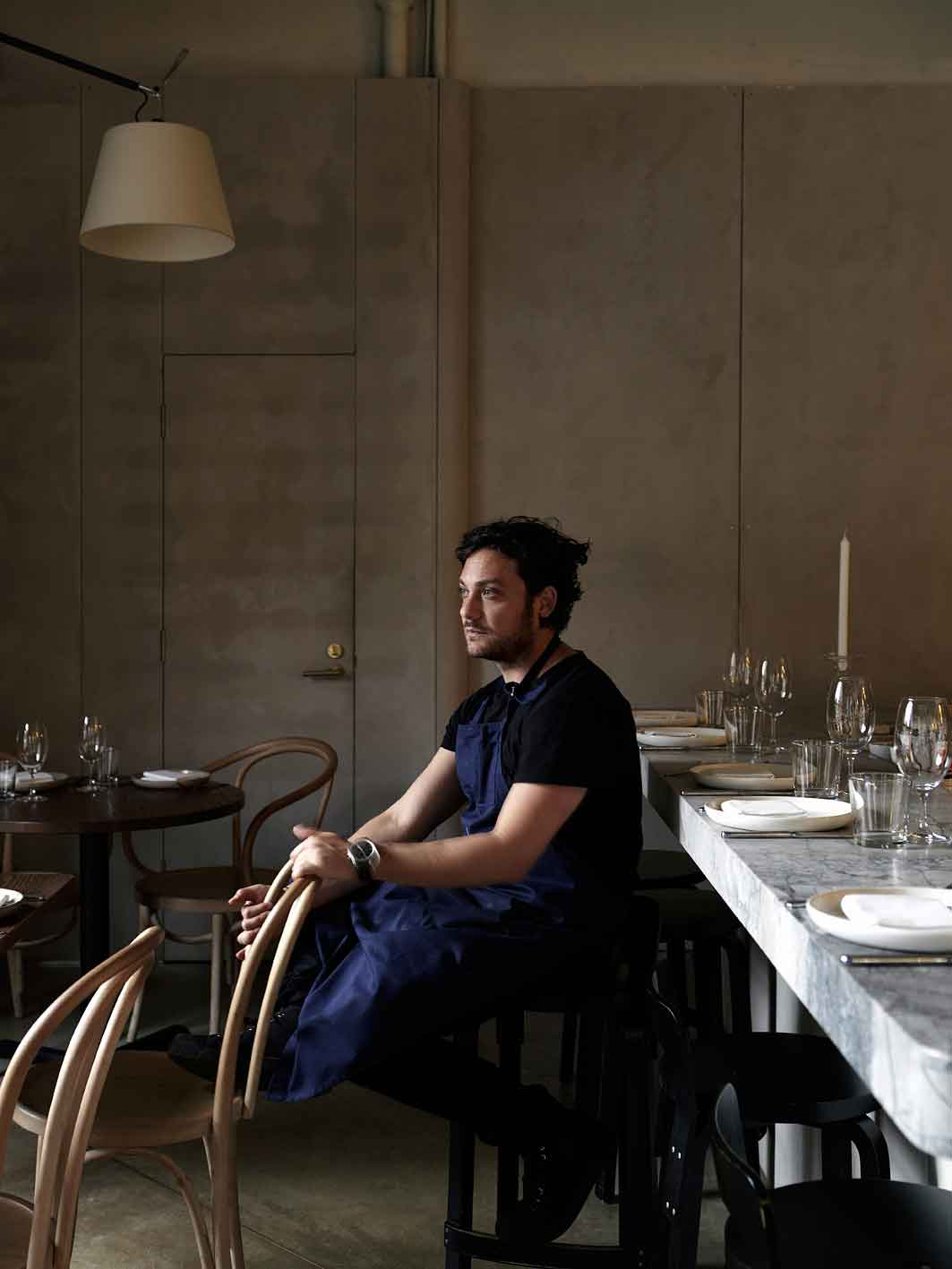 Chef Jonathan Barthelmess in the dining room of Apollo.