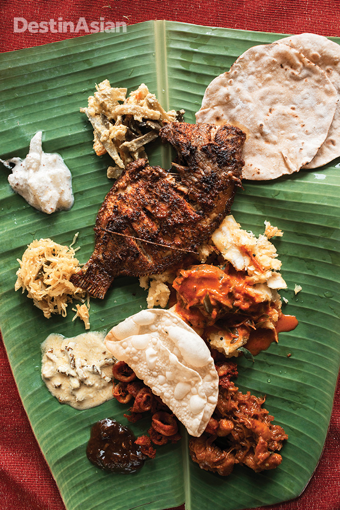 A thali lunch at the Oyster Opera features local fish, mussels, and squid fried in spices.