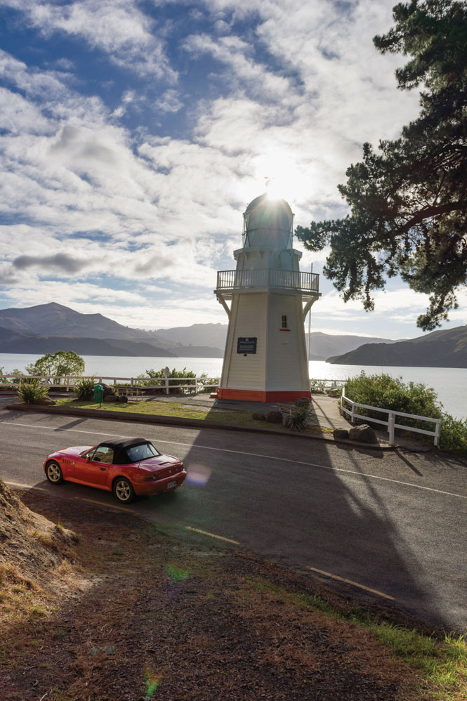 Driving past akaroa's 19th-century lighthouse.