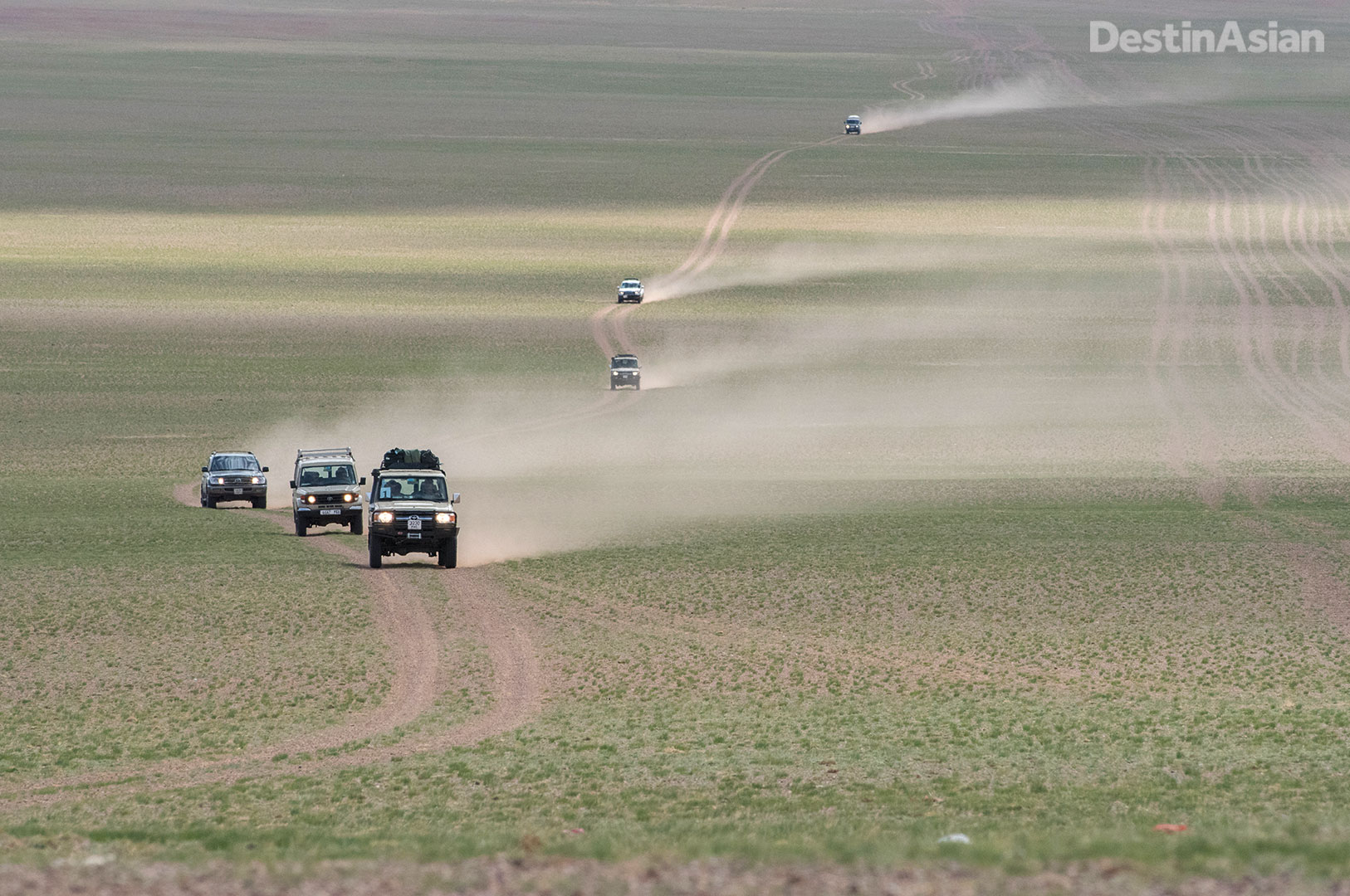 Bruce Elfstrom's convoy crossing an empty stretch of steppe.