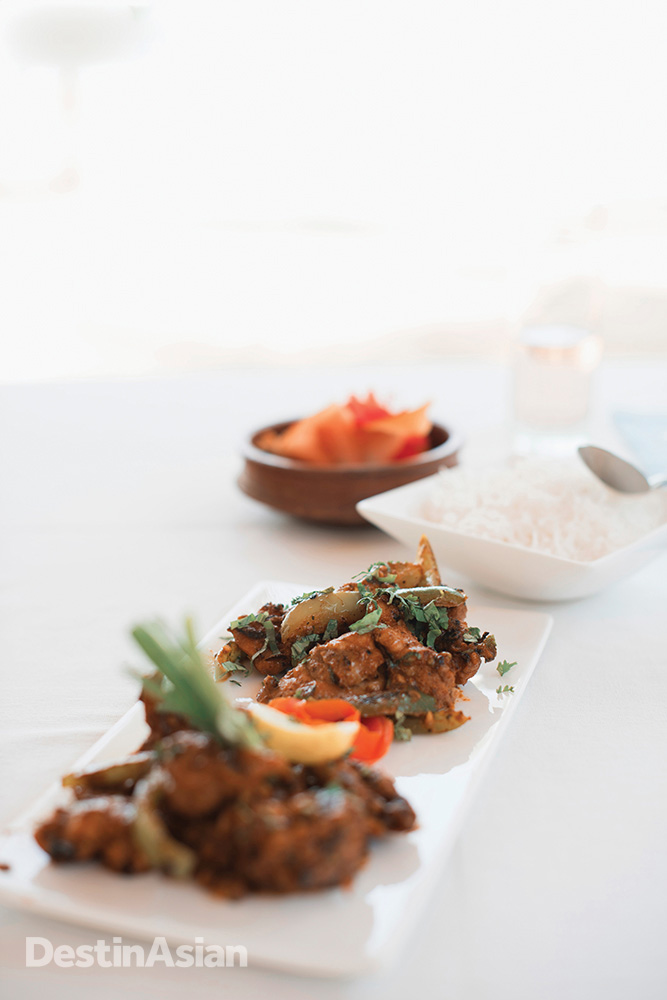A fragrant chicken dish from the kitchen at Neeleshwar Hermitage.