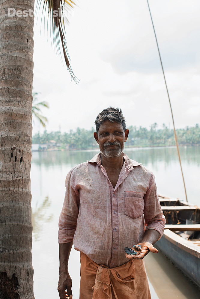 A mussel farmer on Thekkekadu Island.