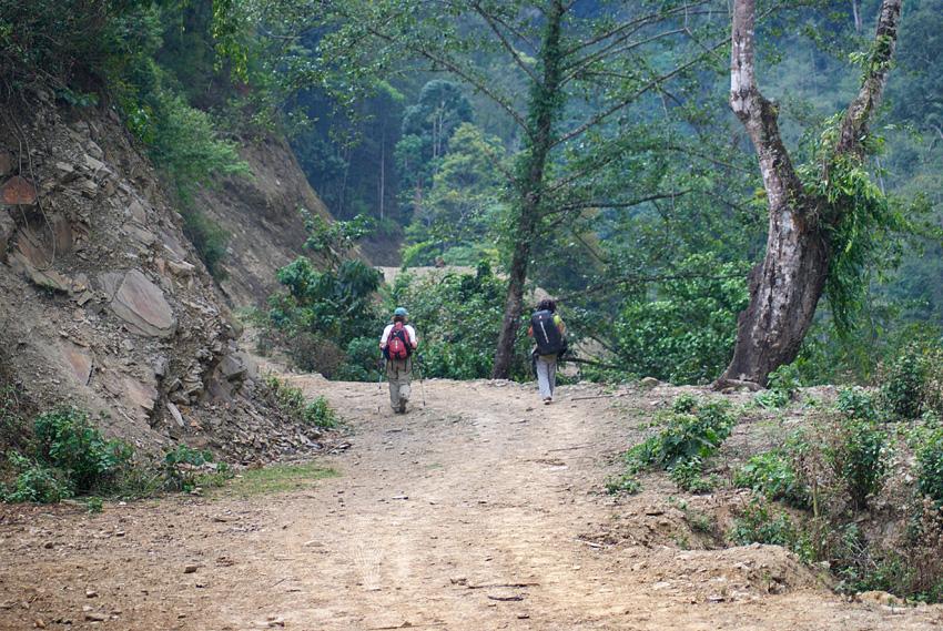 Christina Oko and a porter on the trail to Nabji.