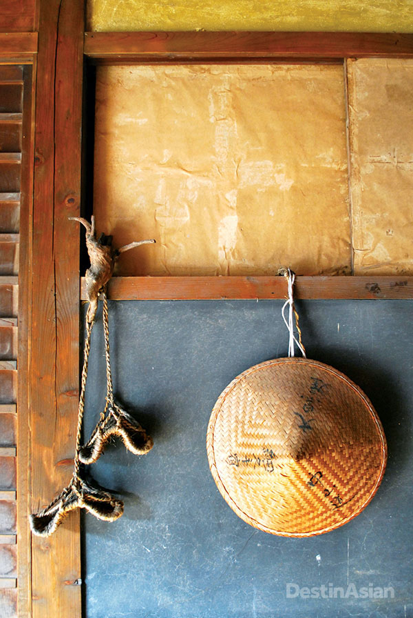 Traditional straw sandals and a hat on display at the Daikokya, an Edo-era inn in the old post town of Hosukute that dates from the 1850s.