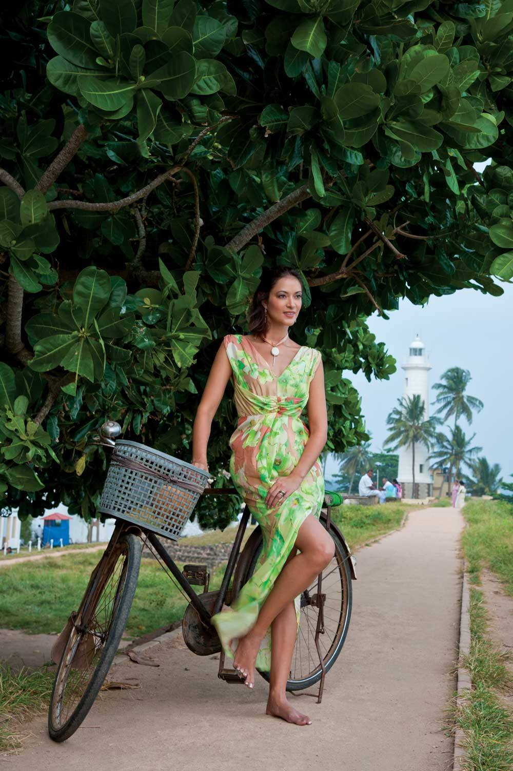 The lanes and almost-car-free streets of Galle Fort lend themselves to exploration by bike; dress by Unspoken, necklace by Killari, from Gnossem.com.