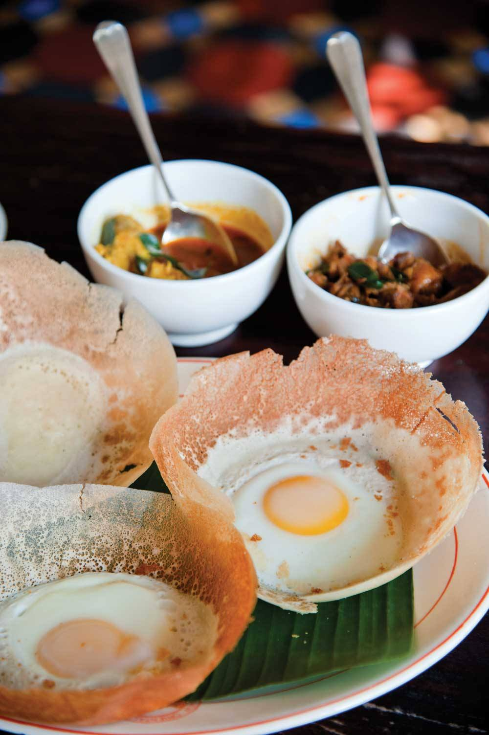 A traditional Sri Lankan breakfast of curries and egg hoppers at Amangalla.