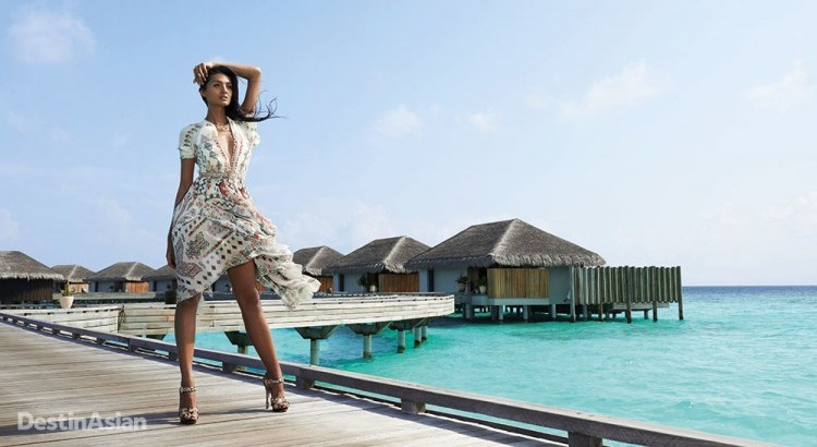 On the pier connecting Velaa Private Island's Water Pool Villas. (Dress by Etro; silver necklace by John Hardy; heels by Michael Kors)