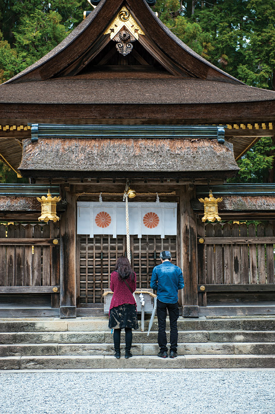 Visitors praying on the grounds of the Kumano Hongu Taisha.