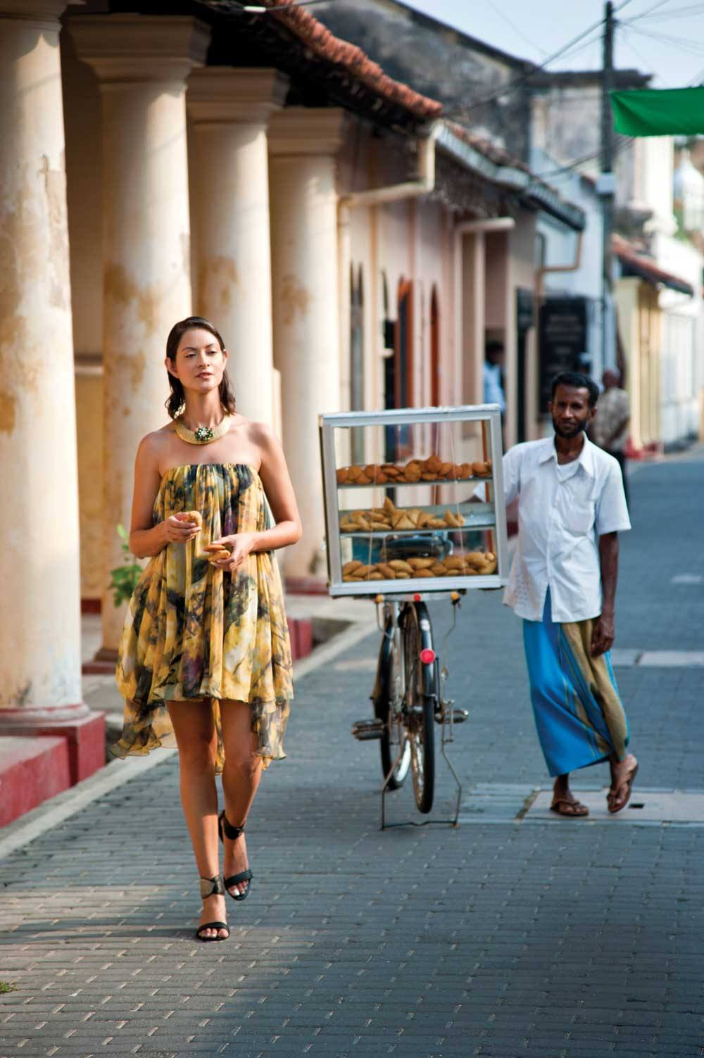 Stocking up on samosas from a Church Street vendor; dress by Justin Yap, necklace by Vasundhara, from Gnossem.com.