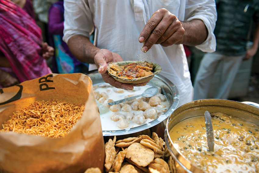 A vendor making papdi chaat.