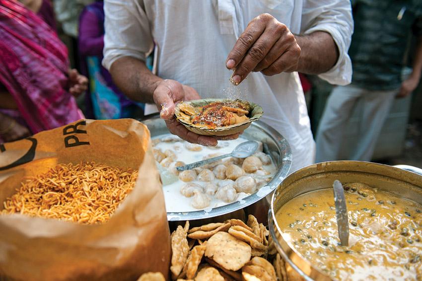 A vendor making papdi chaat.