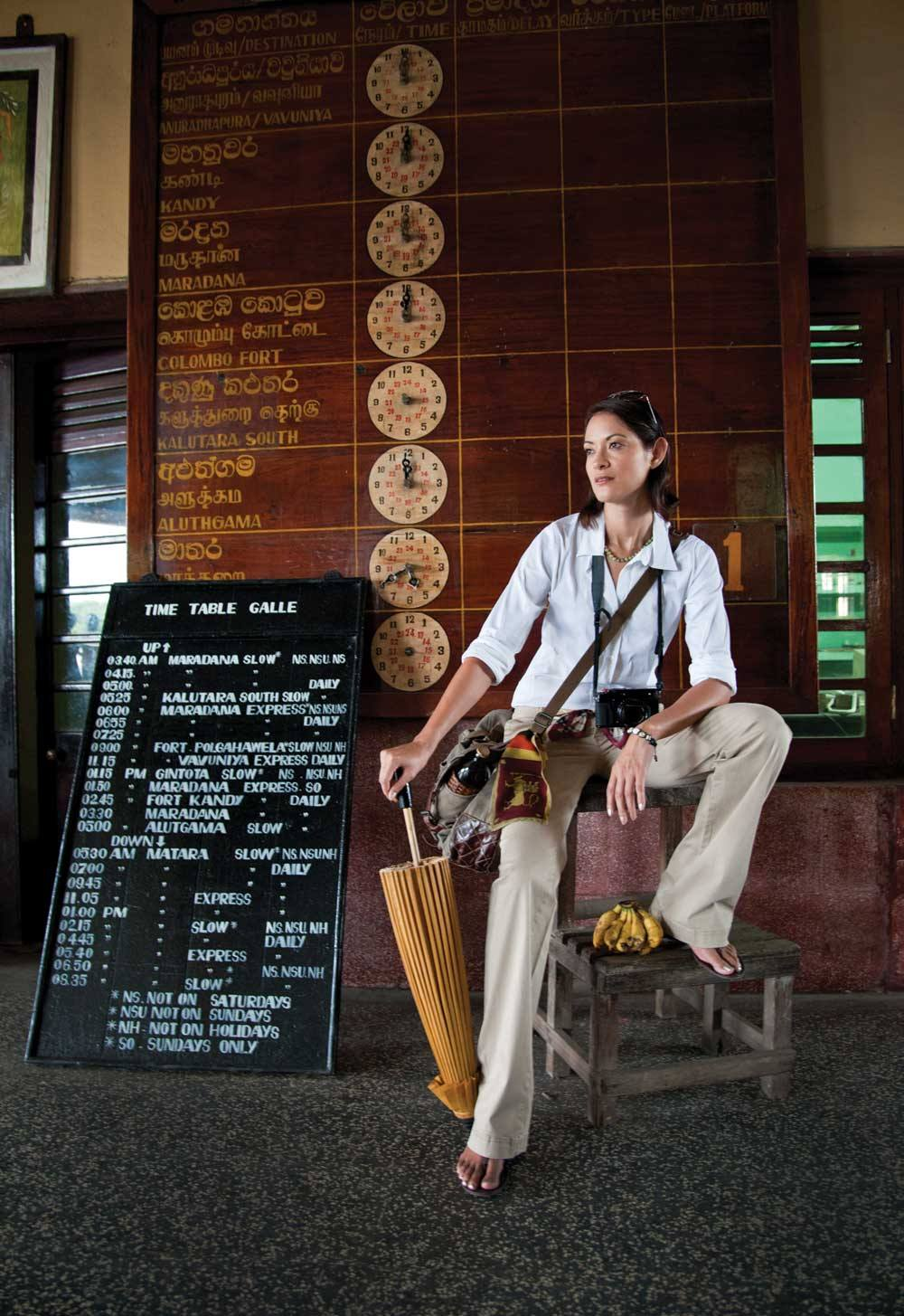 At Galle Railway Station, just north of the Fort; sunglasses by Skagen, camera by Fujifilm, top and pants model's own.