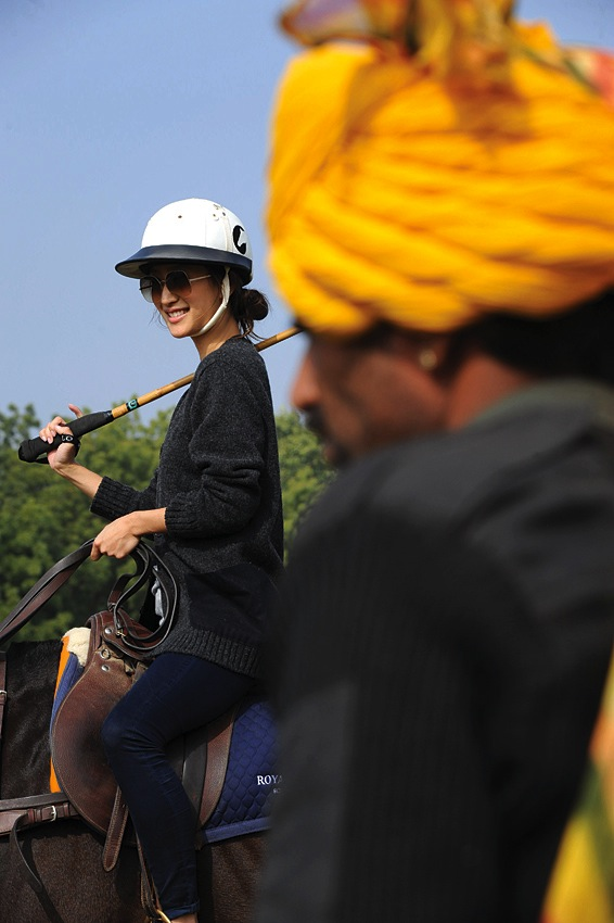 Hong Kong model and actress Jennifer Tse takes the saddles for a lesson in polo basics.