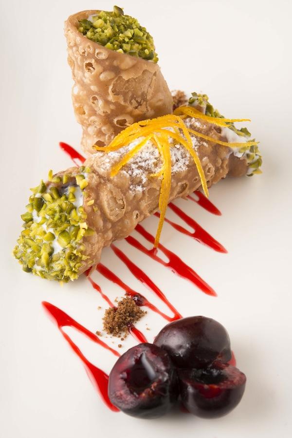 Pistachio-crusted cannoli comes with dark chocolate morello cherries.