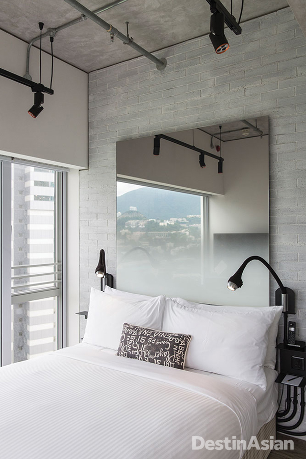 An industrial-chic guest room at Ovolo Southside.