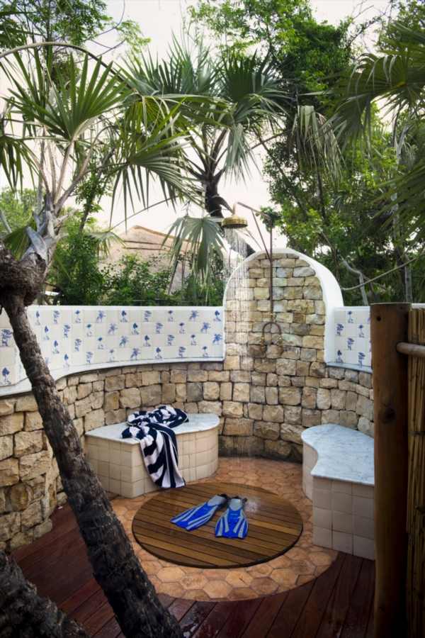 Outdoor showers are tiled with mosaics.