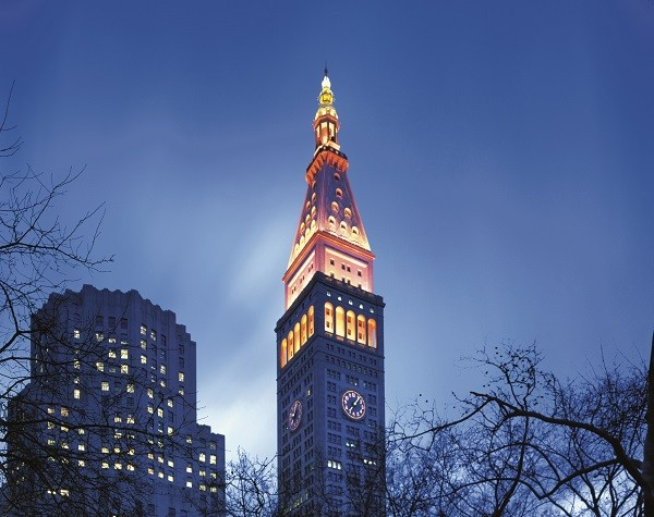 The iconic clock tower on the southeast side of Madison Square Park houses the hotel.