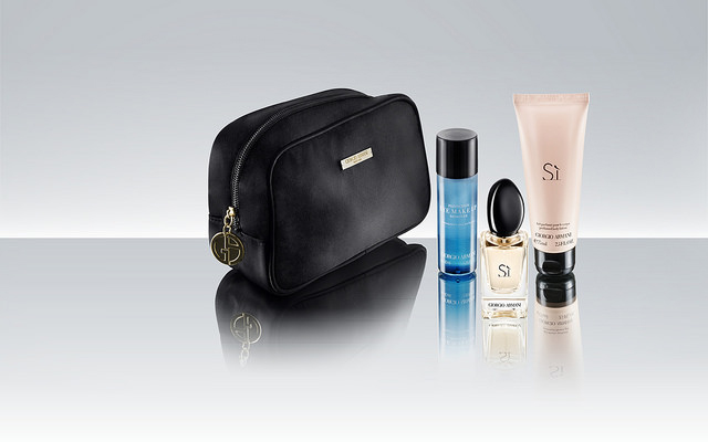 Female premium passengers on Qatar receive kits of toiletries in Armani's Si scent.