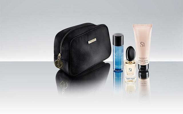 Female premium passengers on Qatar receive kits of toiletries in Armani's Si scent.