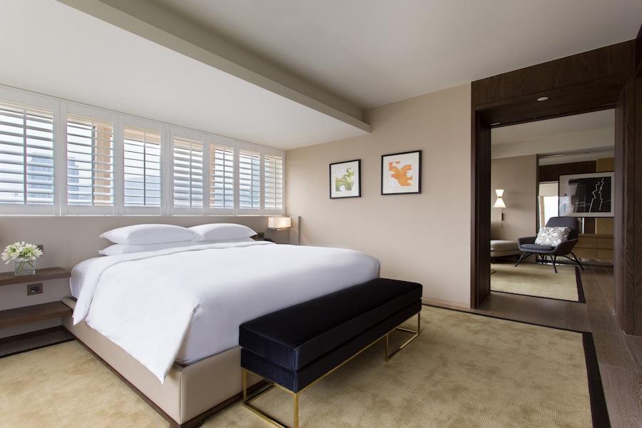 Hotel suites feature separate sitting areas and Ferragamo amenities.
