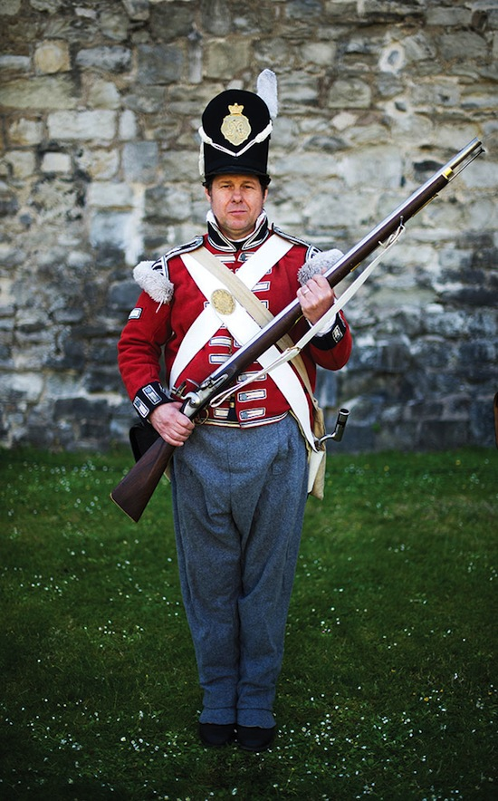 A Battle of Waterloo reenactor in costume as a soldier of the British Foot Guard.