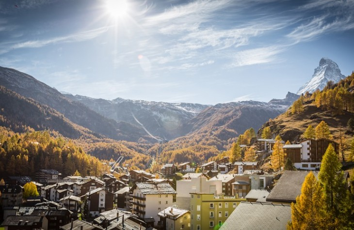 Zermatt in autumn colors, with the Matterhorn rising above (right). © Pascal Gertschen