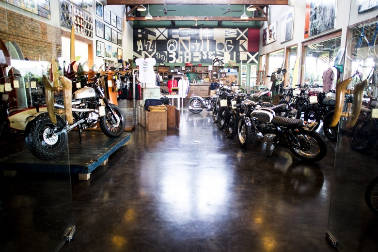 Boards and bikes at Deus Ex Machina.
