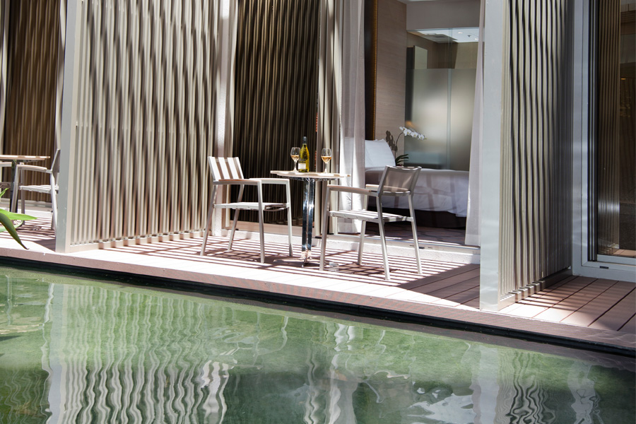 Balcony rooms surround the hotel's quaint koi pond.