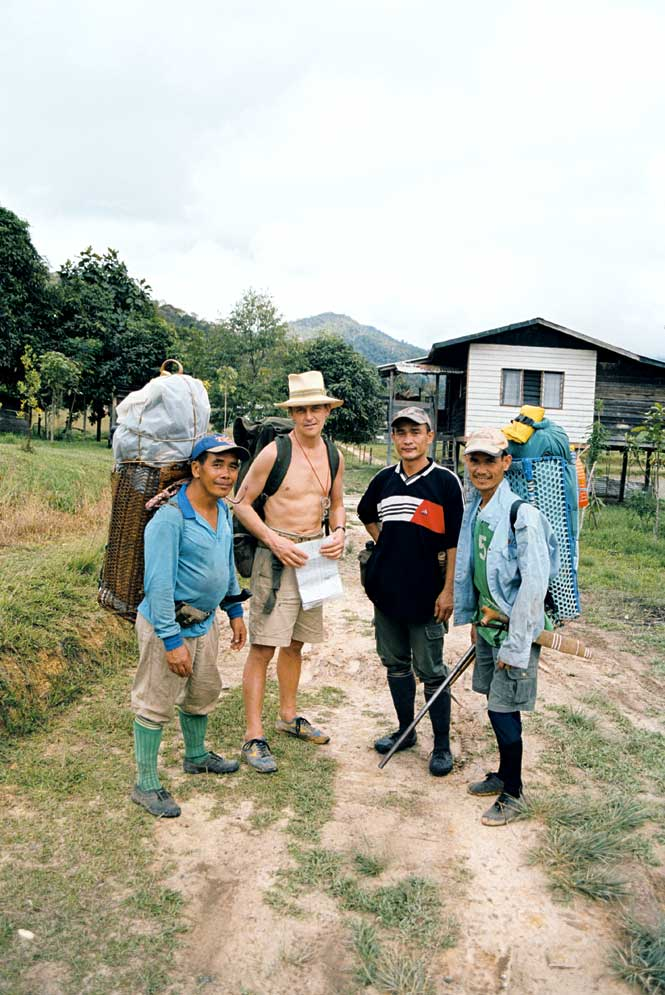 The Author And His Guides Preparing to Set Off From The Kelabit Village of Bario.