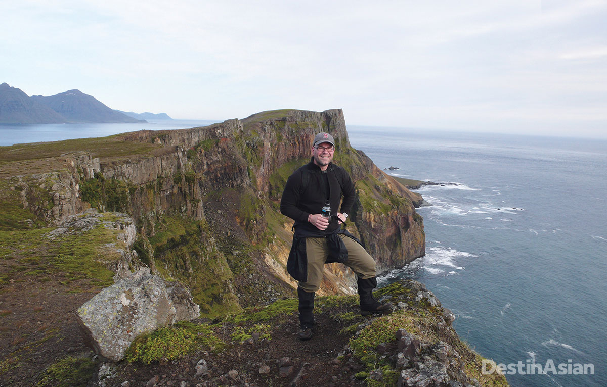 Hiking guide Siggi Olafsson high above the Atlantic surf on the Barðsnes Peninsula.