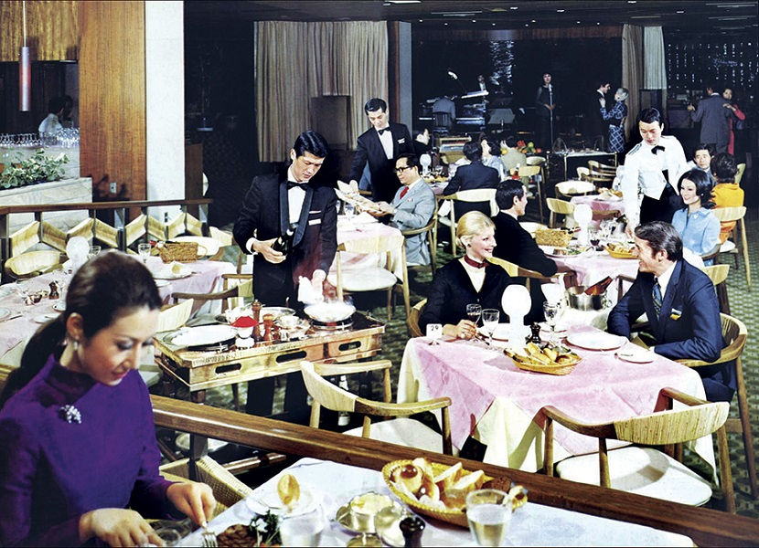 A vintage photo of a banquet at the Hotel Okura's Emerald Room, where waiters still wear tuxedos and bowties.