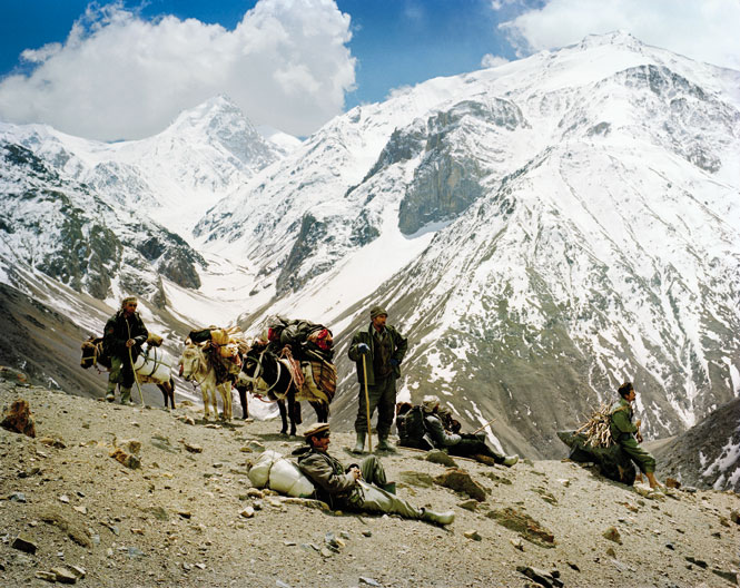 The snow-capped peaks of the Hindu Kush provide the backdrop to a rest stop on the way to the Wakhan Corridor's 4,267-meter Dailz Pass, along a route once plied by Silk Road traders.