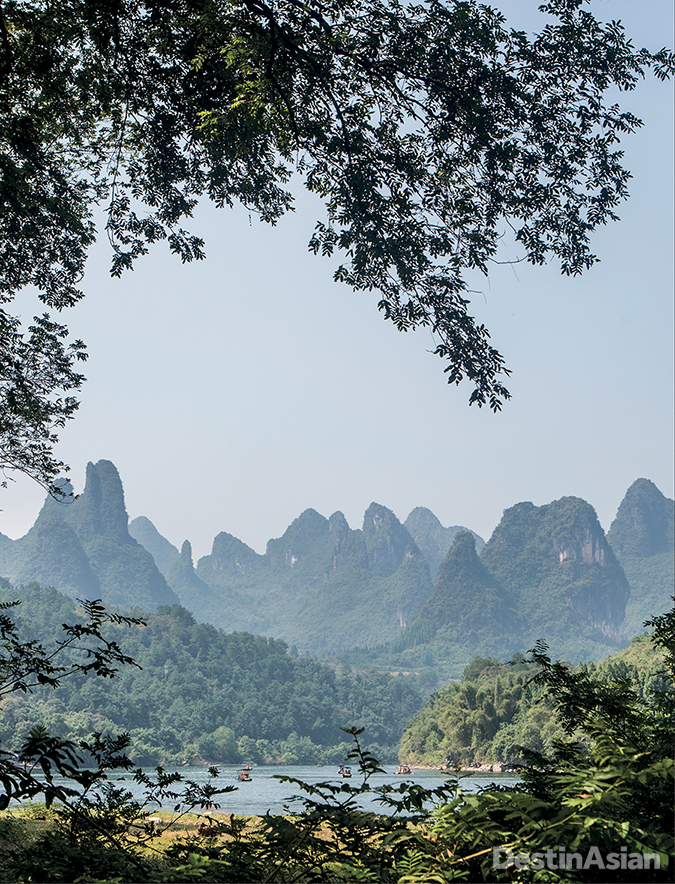 A view across the Li River to distinctive limestone peaks of the Yangshuo area.