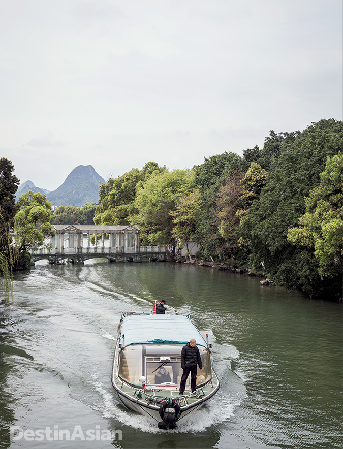 A sightseeing boat on Rong Lake in Guilin City,