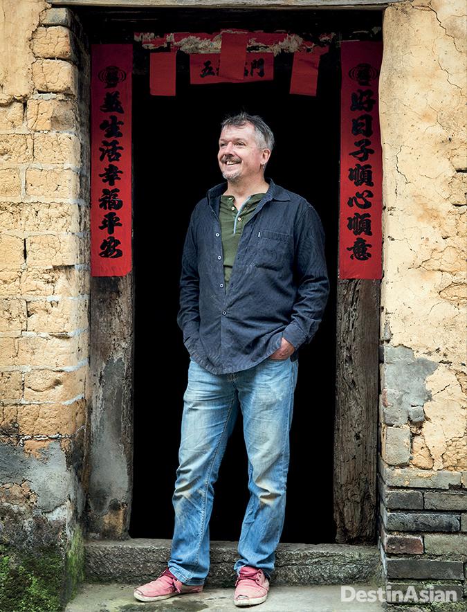 Secret Garden owner Ian Hamlinton in the doorway of a village house in Jiuxian.
