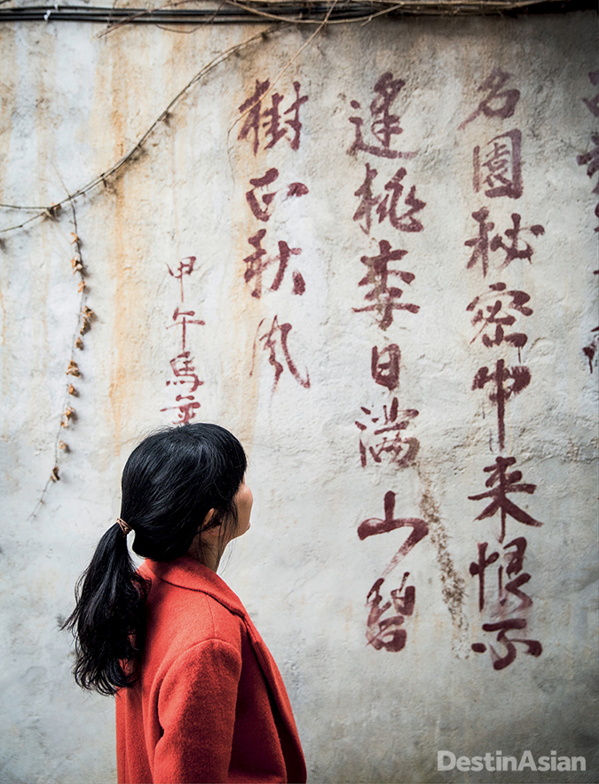Admiring the old Chinese script on a wall at the Secret Garden Boutique Hotel.