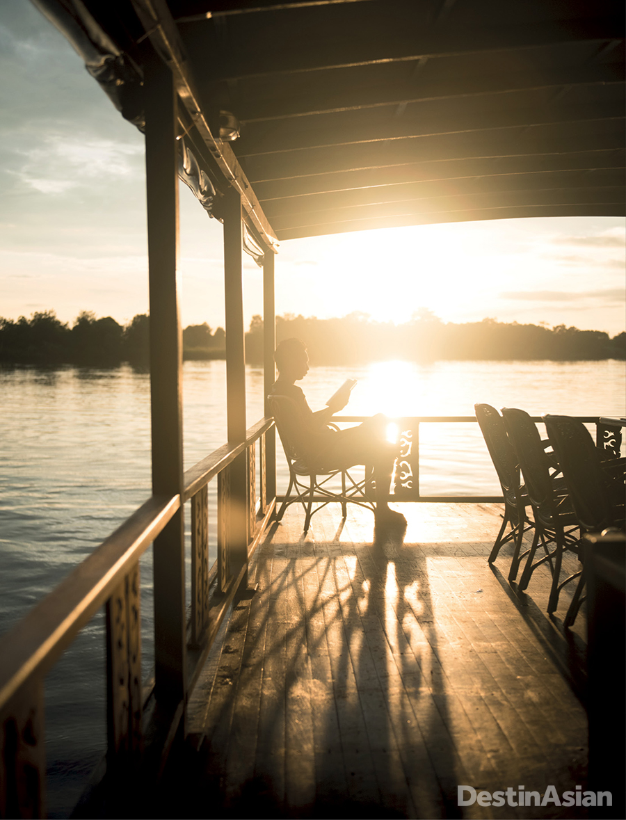 Relaxing on deck as the sun sets over the Central Kalimantan jungle.