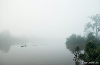 The early fog lifts slowly off the waters of the Rungan River in Central Kalimantan.