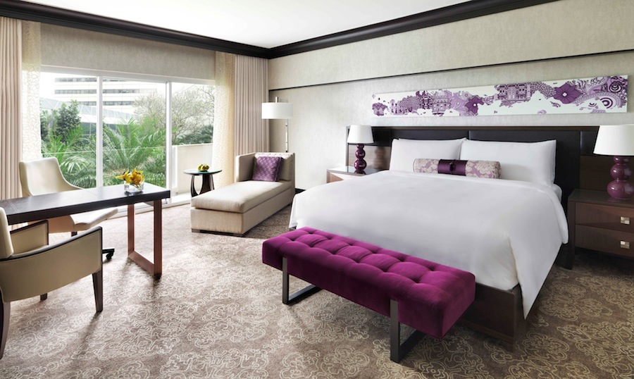 Peranakan touches such as bespoke carpeting and delicate curtains adorn guest rooms.