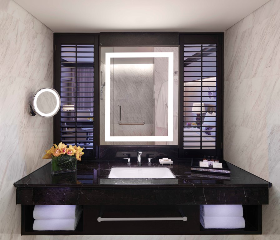 Plantation shutters in guest bathrooms.
