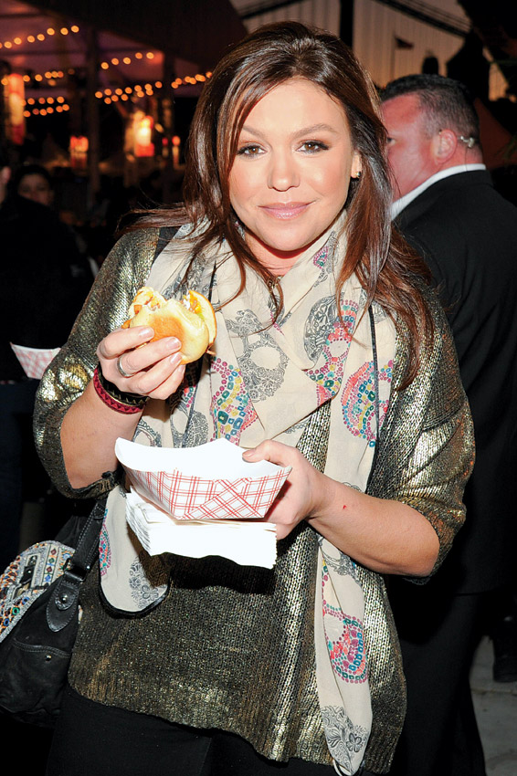 Rachael Ray sampling the fare at the 2012 New York City Wine & Food Festival ©  Billy Farrell Agency