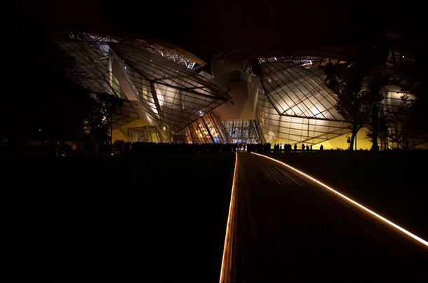 The Frank Gehry-designed building by night.