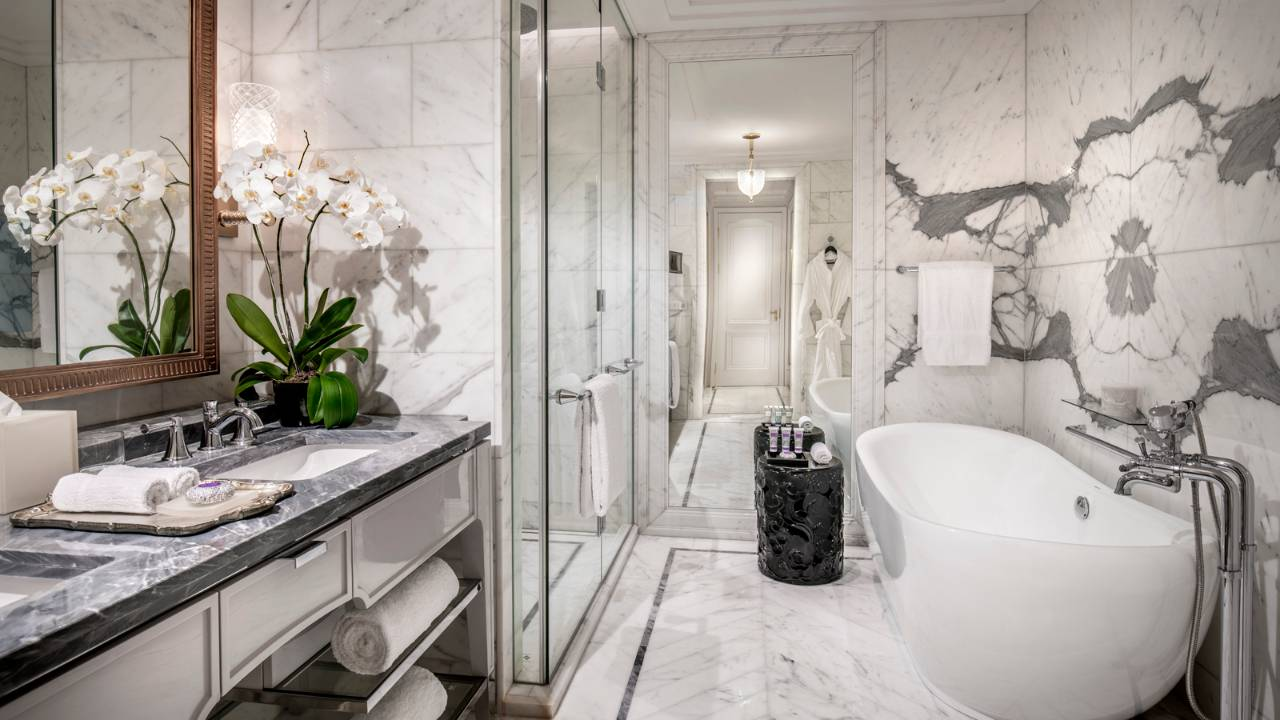 A marbled guest bathroom