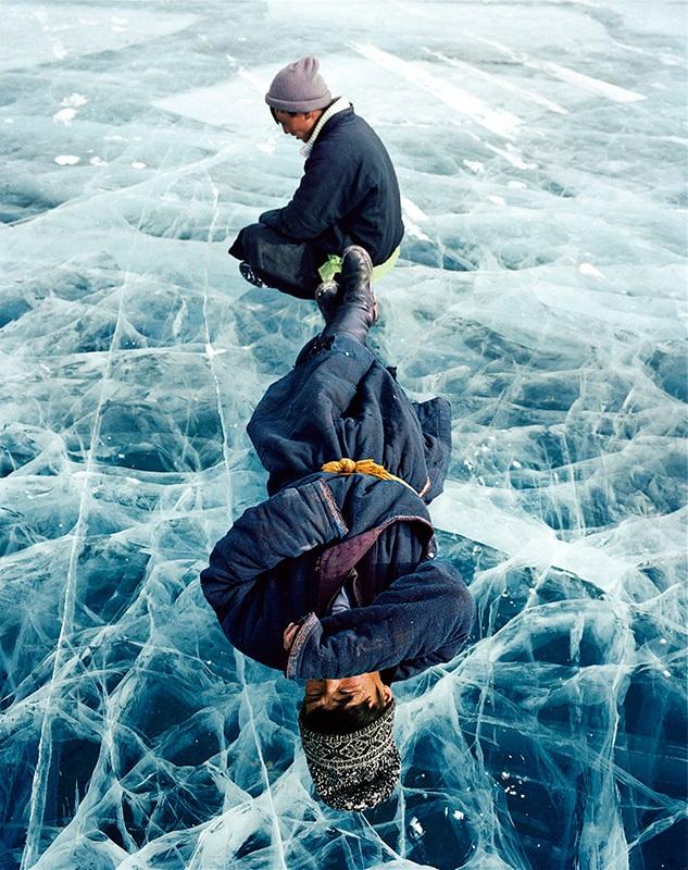 Men at rest on the winter ice of northwest Mongolia's Lake Khövsgöl, by Frédéric Lagrange.