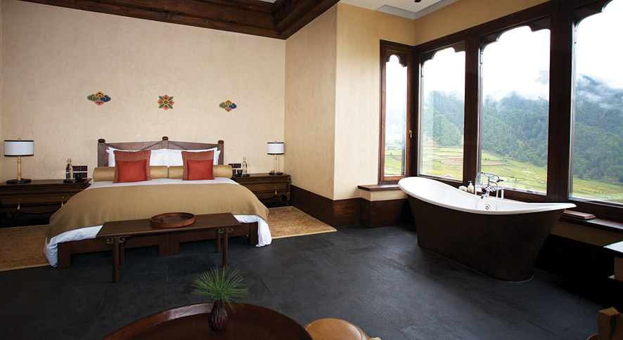 Rooms come with luxury features including heated stone floors, freestanding bathtubs, and plush sofas.