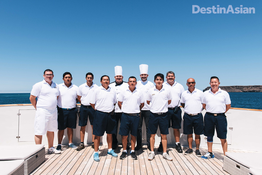 All hands on deck—the captain and crew of the MV Origin, the newest vessel in the Ecoventura fleet.