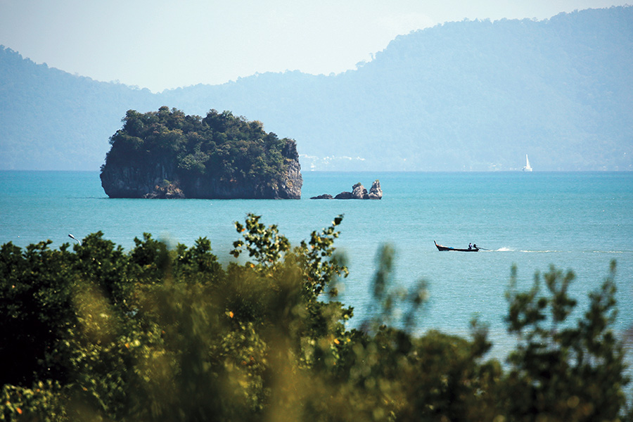 Serene Koh Yao Yai is situated in the middle of karst-strewn Phang Nga Bay (iStock).