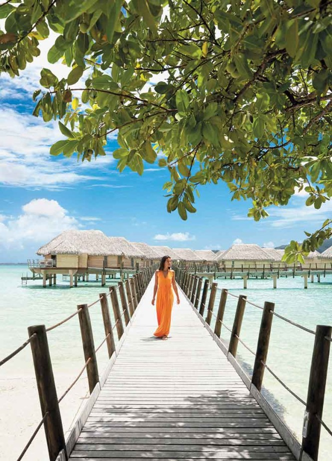 On the jetty connecting Le Taha'a Island to its bamboo-sided Overwater Suites.